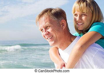 father and daughter piggyback
