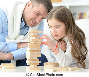 Father and daughter playing a game