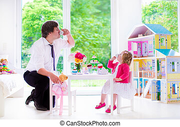 Father and daughter playing doll tea party - Happy family,...