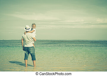 father and daughter playing on the beach