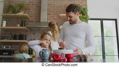 Father and daughter preparing cookie on worktop in kitchen at home 4k