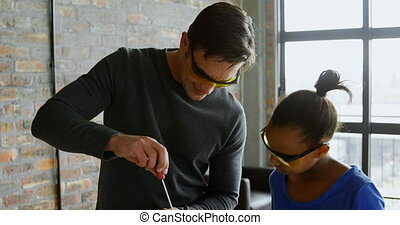 Father and daughter repairing a drone 4k - Father and ...