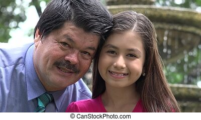 Father and Daughter Smiling at Fountain