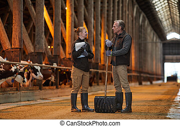 Father and Daughter Talking at Family Farm