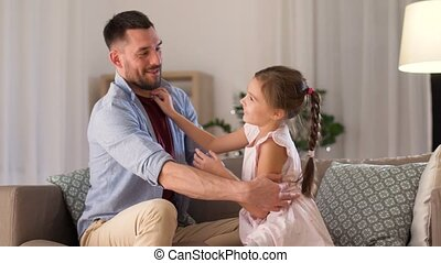 father and daughter tickling and having fun - family,...