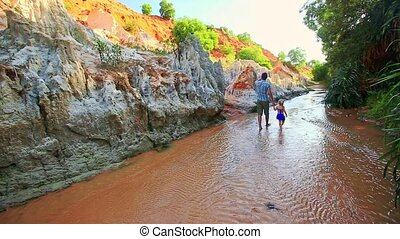 Father and Daughter Walk along Shady Fairy Stream - Father...