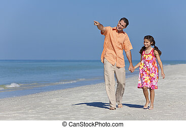 Father and Daughter Walking Holding Hands on Beach