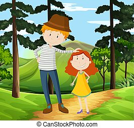 Father and Daughter walking in a park