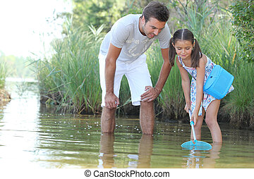Father and daughter with a fishing net