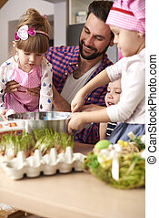 Father and his little girls in the kitchen