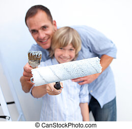 Father and his son painting a room