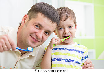father and kid brushing teeth in bathroom