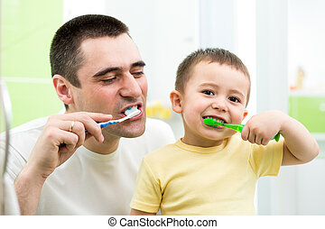 father and kid son brushing teeth in bathroom