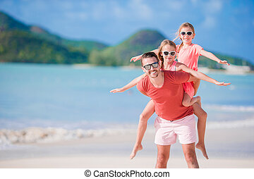 Father and kids enjoying beach summer vacation