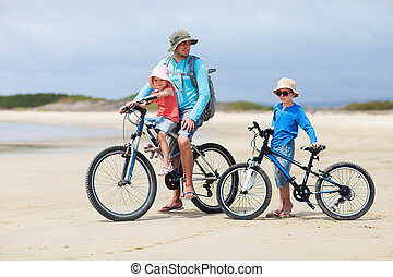 Father and kids riding bikes