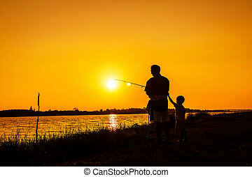 father and little boy fishing in the river