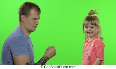 Father and little daughter playing rock paper scissors. Chroma Key. Leisure game