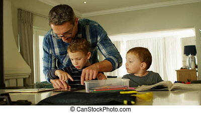 Father and siblings using digital tablet in living room 4k