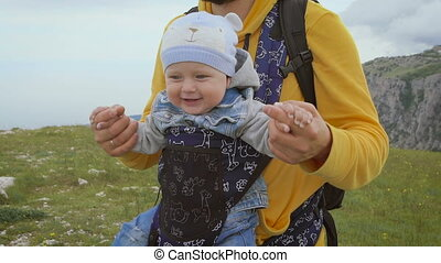 Father and son are traveling together. Pope carries his...