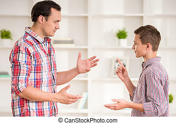 Father and son at home - Father and son dressed casual...