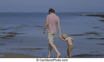 Father and Son bonding time - A happy father and son walk...