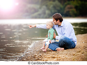 Father and son by the lake