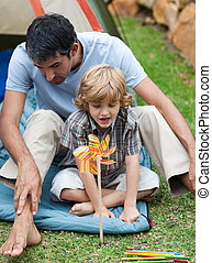 Father and son camping - Smiling father and son camping