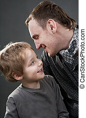 Father and son cheerfully talk.