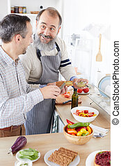 Father and son cooking in the kitchen