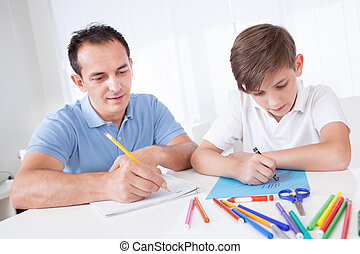 Father And Son Drawing Together With Colorful Pencils And...