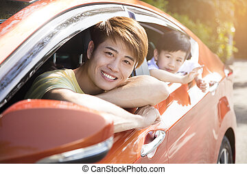 father and son enjoy road trip in summer