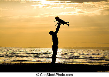 Father and Son - Father throwing his kid up in the air on ...