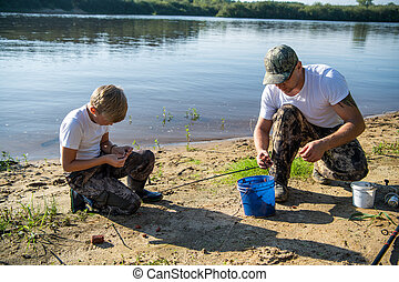 Father and son fishing on the lake together. - Father and ...