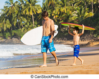 Father and Son Going Surfing Together on Tropical Beach in...