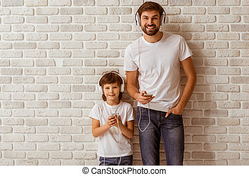 Father and son - Handsome young father and his cute little...