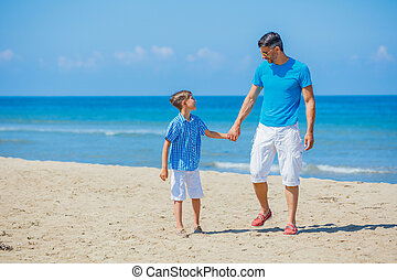 Father and son having fun at beach together.