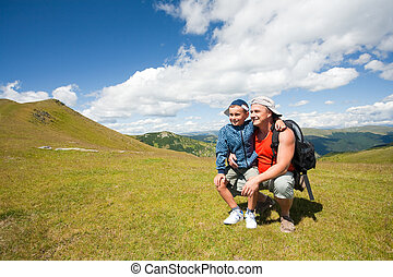 Father and son hiking in the mountains