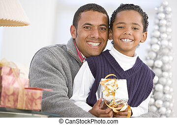 Father And Son Hugging, Holding Christmas Gift