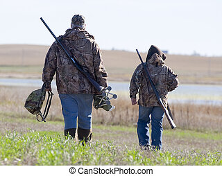 Father and Son Hunting - Father and son on their way duck...