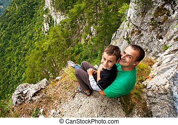 Father and son in mountains