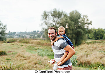 Father and son in nature in summer park