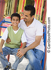 Father and son in playground