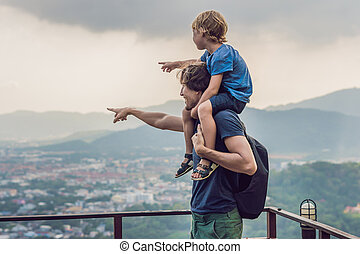 Father and son in the background of Phuket Town view from ...