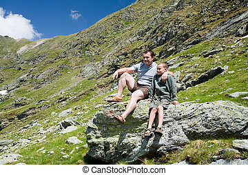 Father and son in the mountains