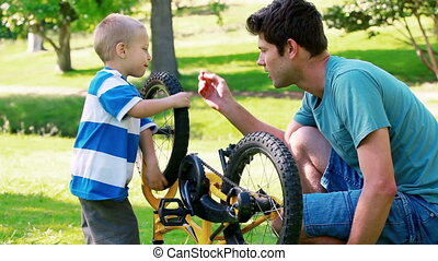 Father and son looking a bike