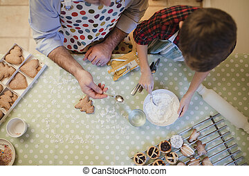 Father And Son Making Christmas Treats