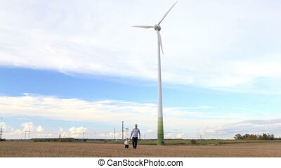 Father and son near the wind turbine
