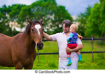 Father and son on a horse farm