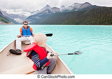 father and son on a lake