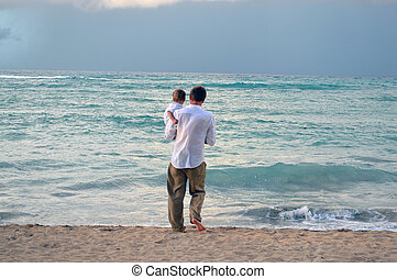 Father and son on the beach - This is a photo of a father...